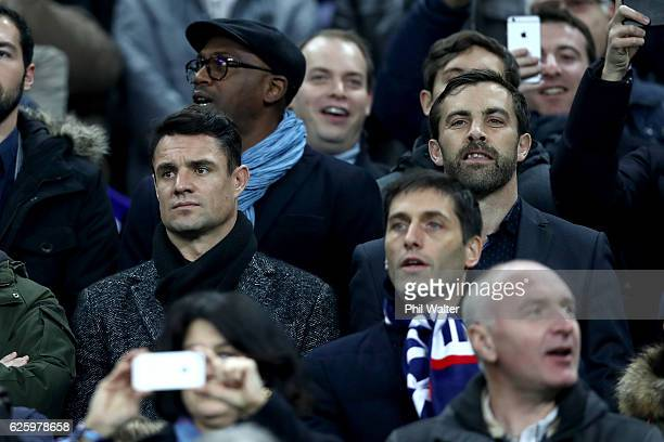 Former All Blacks Dan Carter and Conrad Smith in the crowd before the international rugby match between France and New Zealand at Stade de France on...