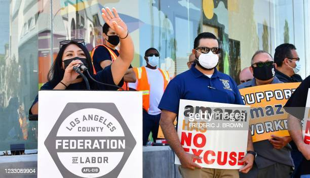Former Amazon worker Yesenia Barrera gestures while addressing the crowd as supporters protest in front of Fidelity Investments, one of the company's...
