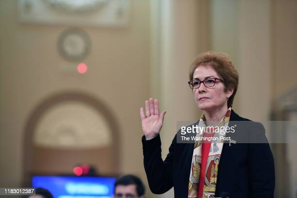 Former Ambassador to Ukraine Marie Yovanovitch is sworn in as she appears before the House Intelligence Committee during an impeachment hearing at...