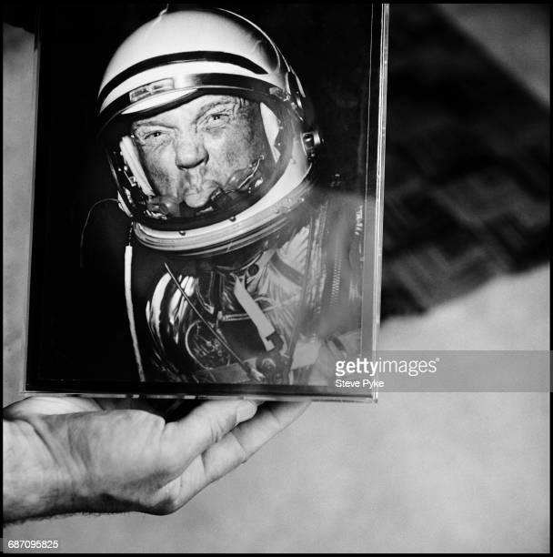 Former American astronaut and Democrat politician John Glenn holding a photo of himself Washington DC 26th April 1999 The portrait shows Glenn...