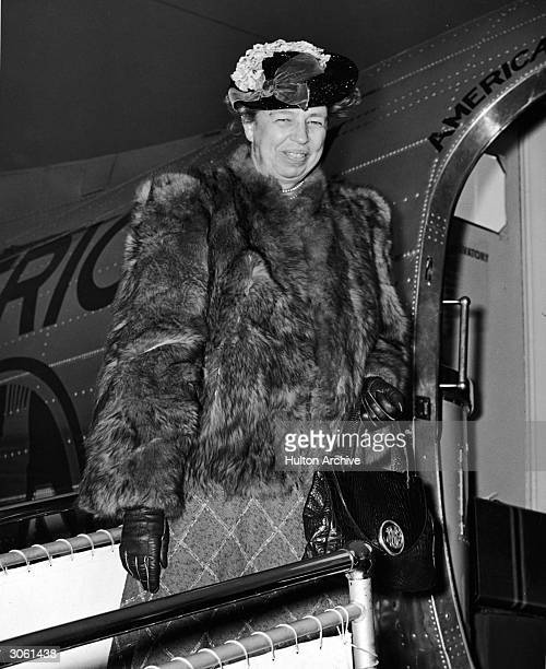 Former American First Lady and diplomat Eleanor Roosevelt smiles while boarding a plane wearing a fur coat early 1950s