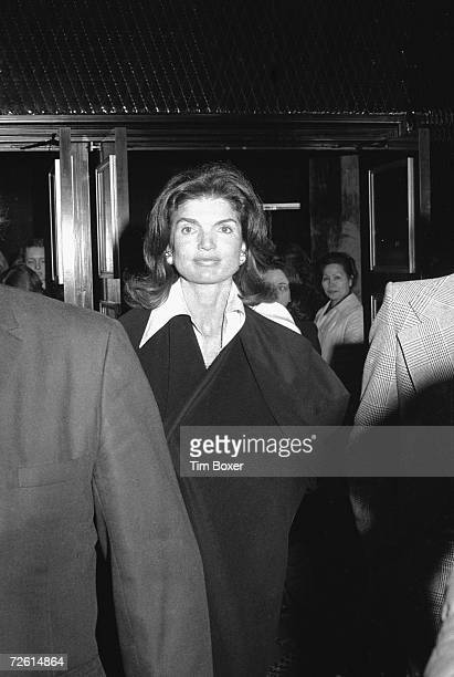 Former American First Lady Jacqueline Kennedy Onassis walks through the crowd in the lobby of the Ziegfeld Theatre after an invitational advanced...