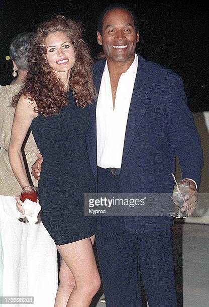Former American football player and actor O J Simpson with actress Paula Barbieri circa 1993