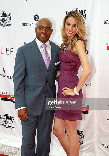 Former American football player Tiki Barber and his wife Traci Lynn Johnson attend the Julep Ball 2013 during the 139th Kentucky Derby at KFC YUM...