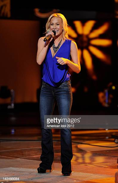 Former American Idol contestant Kellie Pickler performs onstage at FOX's 'American Idol' Season 11 Top 8 To 7 Live Elimination Show on April 5 2012...