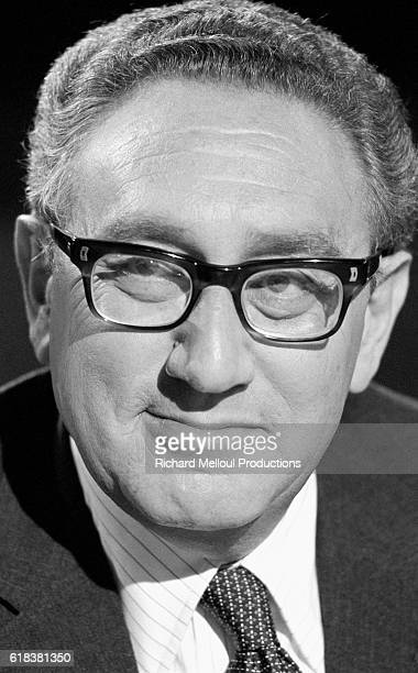 Former American Secretary of State Henry Kissinger appears on the French television show Cartes sur Table TV journalists JeanPierre Elkabbach and...
