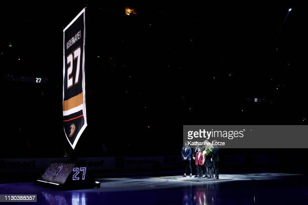Former Anaheim Ducks player Scott Niedermayer and family watch as Niedermayer's jersey is lifted to the rafters upon being retired during a ceremony...
