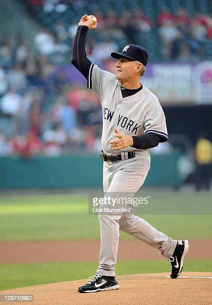 Former Angel and fist base coach Mike Kelleher of the New York Yankees throws out the first pitch against the Los Angeles Angels of Anaheim at Angel...