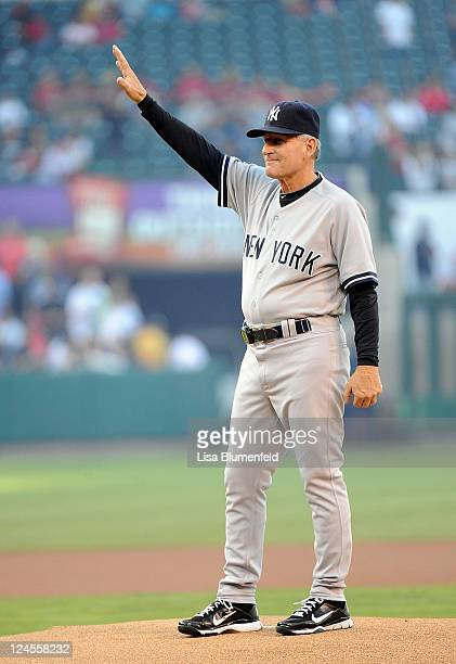Former Angel and fist base coach Mike Kelleher of the New York Yankees acknowledges the crowd before throwing out the first pitch against the Los...