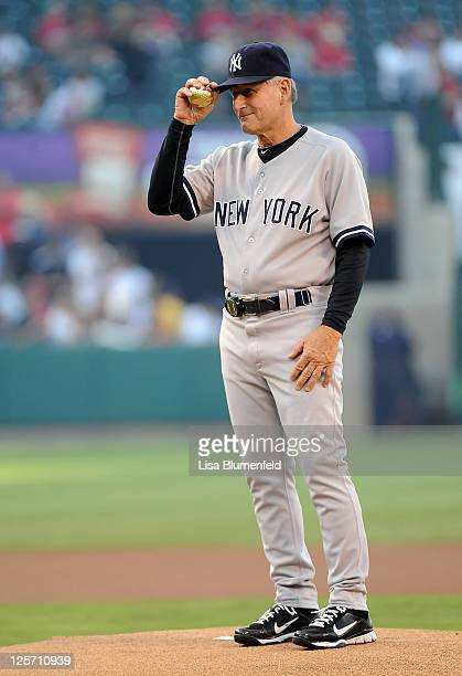 Former Angel and fist base coach Mike Kelleher of the New York Yankees prepares to throw out the first pitch against the Los Angeles Angels of...
