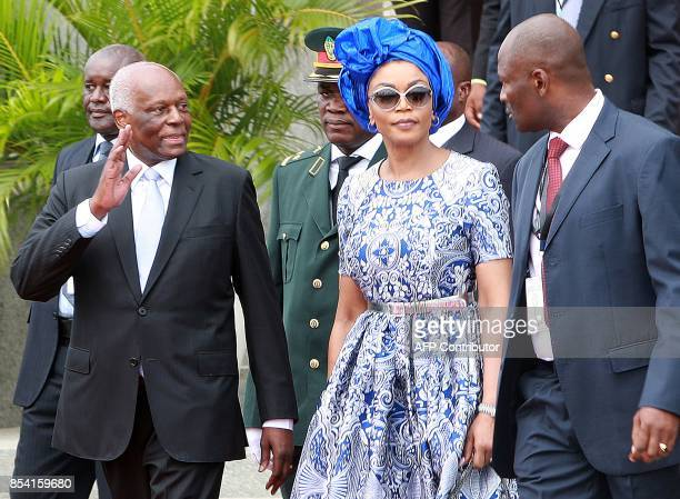 Former Angolan President Jose Eduardo dos Santos waves during the swearing in ceremony of the new president of Angola on September 26 2017 in Luanda...