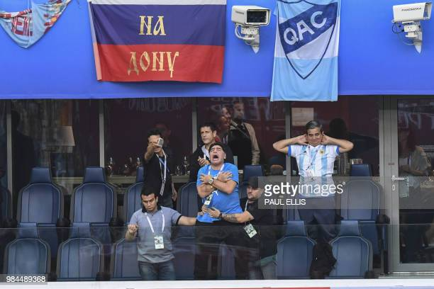 TOPSHOT Former Argentina forward Diego Maradona celebrates the opening goal during the Russia 2018 World Cup Group D football match between Nigeria...