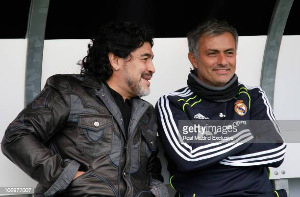 Former Argentina player and manager Diego Maradona chats with head coach Jose Mourinho of Real Madrid during a training session at the Valdebebas...