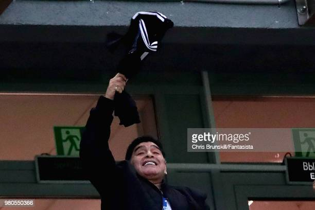Former Argentina player Diego Maradona swings a shirt around his head before the 2018 FIFA World Cup Russia group D match between Argentina and...