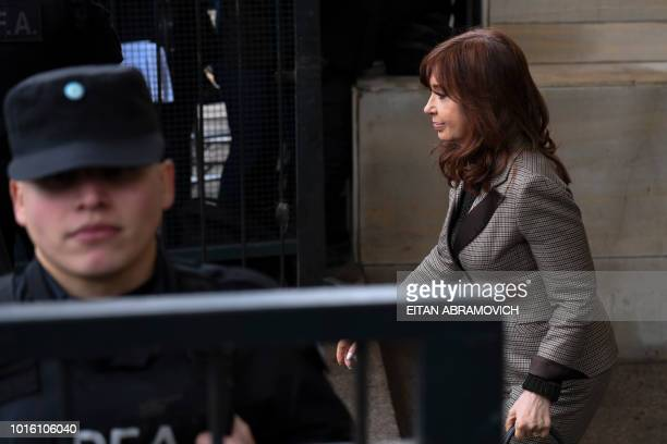 TOPSHOT Former Argentina president Cristina Kirchner leaves a federal court in Buenos Aires on August 13 2018 Kirchner appeared before judge running...