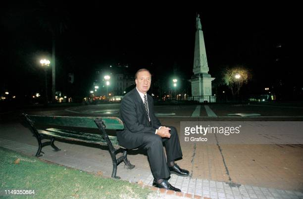 Former Argentina World Cup winning coach Carlos Bilardo poses during a private photo session for El Gráfico magazine at May Square on March 2003 in...