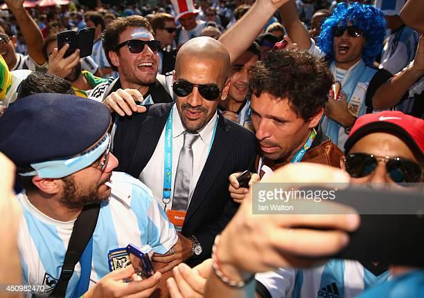 Former Argentinan international Juan Sebastian Veron arrives ahead of the 2014 FIFA World Cup Brazil Group F match between Argentina and Iran at...