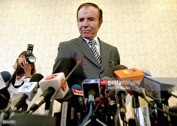 Former Argentina's President Carlos Menem attends a press conference in Santiago Chile 13 April 2004 Menem announced he will not appear in court...