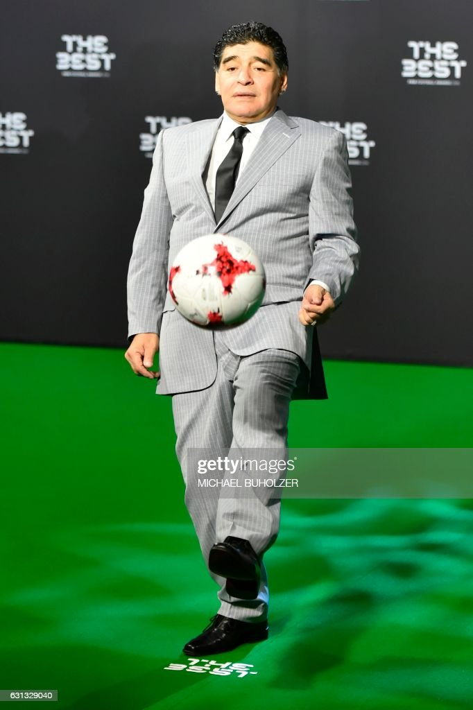 TOPSHOT - Former Argentine football player Diego Maradona plays the ball as he arrives for The Best FIFA Football Awards 2016 ceremony, on January 9, 2017 in Zurich.