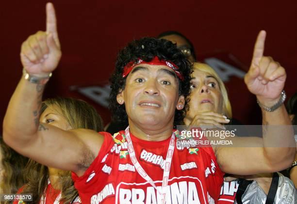 Former Argentine football star Diego Maradona dances during Rio de Janeiro's samba school parade 26 February 2006 AFP PHOTO/VANDERLEI ALMEIDA