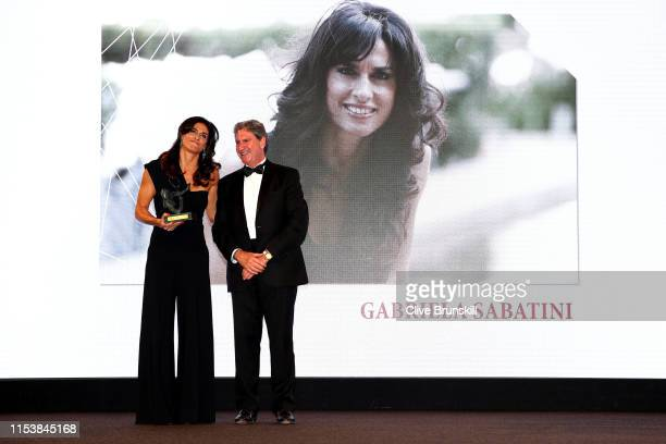 Former Argentine Grand Slam winner Gabriela Sabatini accepts the Philippe Chattier award from ITF President David Haggerty during the ITF World...