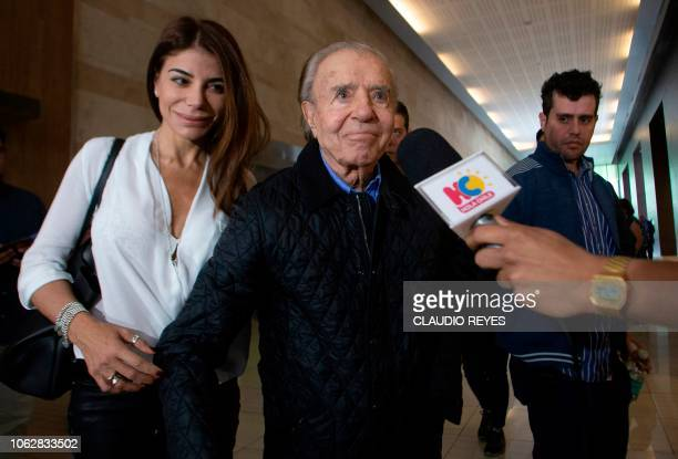 Former Argentine President and current senator Carlos Menem arrives with his daughter Zulema Menem and his son Carlos Nair Menem at Las Condes clinic...