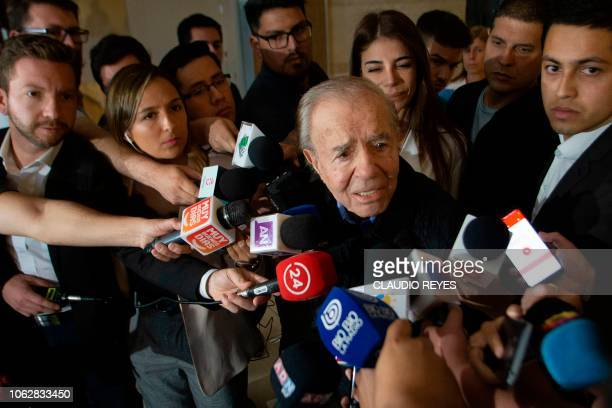 Former Argentine President and current senator Carlos Menem delivers a press conference at Las Condes clinic in Santiago on November 17 where his...