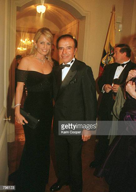 Former Argentine President Carlos Menem and girlfriend Cecilia Bolocco a former Miss Universe leave a party at the Embassy of Ecuador residence in...
