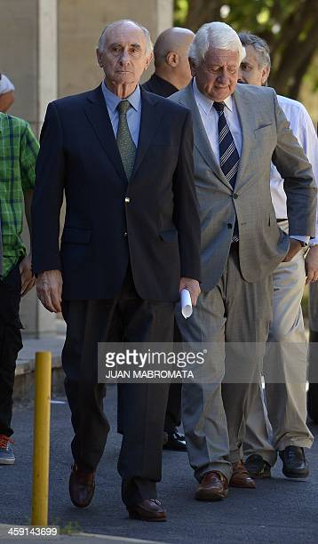 Former Argentine President Fernando De La Rua heads to speak with the press after being acquitted on bribery charges outside Argentina's Federal...
