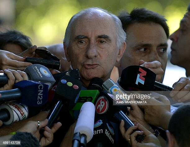 Former Argentine President Fernando De La Rua speaks with the press after being acquitted on bribery charges outside Argentina's Federal Court in...