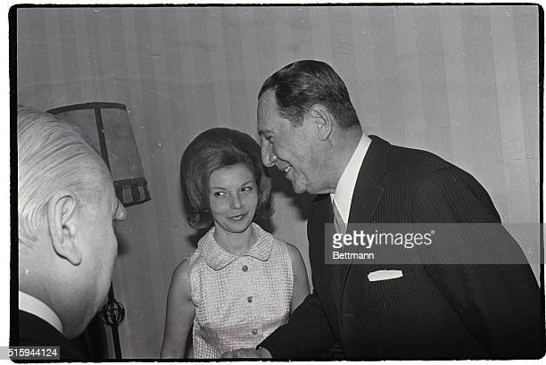Former Argentine president Juan Peron and his wife Isabel at a cocktail party in Madrid | Location Madrid Spain