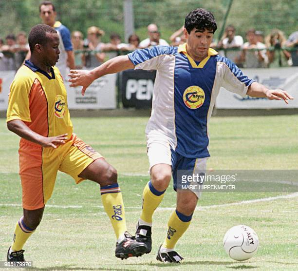Former Argentine soccer player Diego Maradona fights for the ball with an unidentified player 31 January in Campinas Brazil 100km from Sao Paulo...