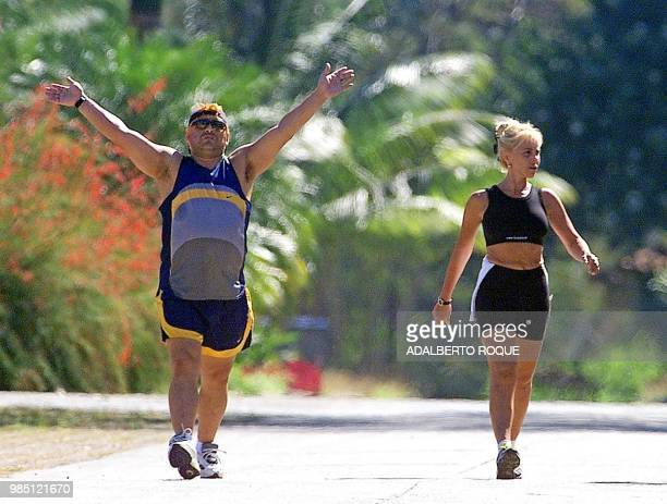 Former Argentine soccer star Diego Armando Maradona and his wife Claudia Villafane go for a walk in the garden of the Hotel Las Praderas 22 January...