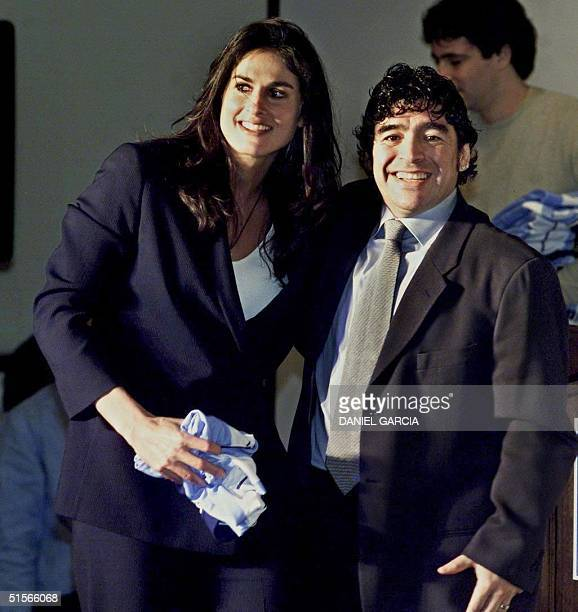 Former Argentine soccer star Diego Maradona poses with his compatriot and former tennis star Gabriela Sabatini during the official launch of...