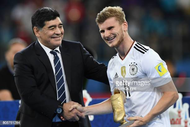 TOPSHOT Former Argentinian ace footballer Diego Maradona congratulates Germany's forward Timo Werner as he is awarded the Golden Boot for best scorer...