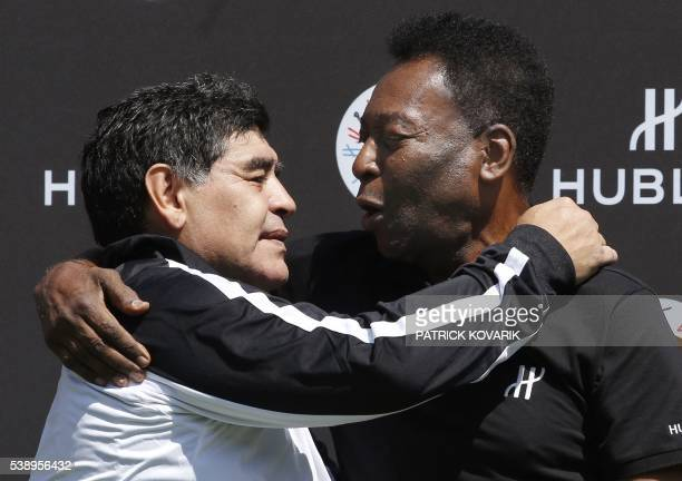Former Argentinian football international Diego Maradona and former Brazilian footballer Pele pose after a football match organised by Swiss luxury...