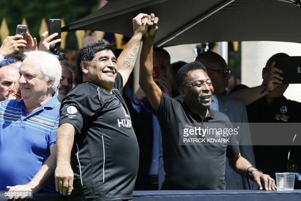 TOPSHOT Former Argentinian football international Diego Maradona and former Brazilian footballer Pele attend a football match organised by Swiss...