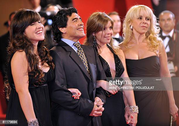 Former Argentinian football player Diego Maradona arrives with his daughters Giannina and Dalma and wife Claudia to attend the screening of Serbian...