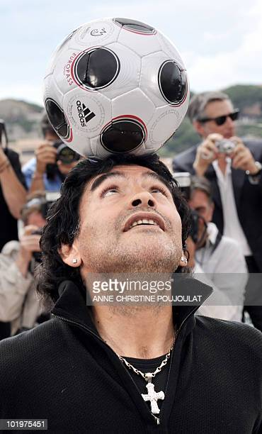 Former Argentinian football player Diego Maradona controls the ball during a photocall for Serbian director Emir Kusturica's film 'Maradona by...