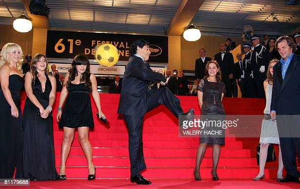 Former Argentinian football player Diego Maradona dribbles with a ball surrounded by his wife of Claudia daughters Dalma and Giannina Serbian...