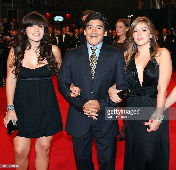 Former Argentinian football player Diego Maradona flanked by his daughters Giannina and Dalma arrives to attend the screening of Serbian director...