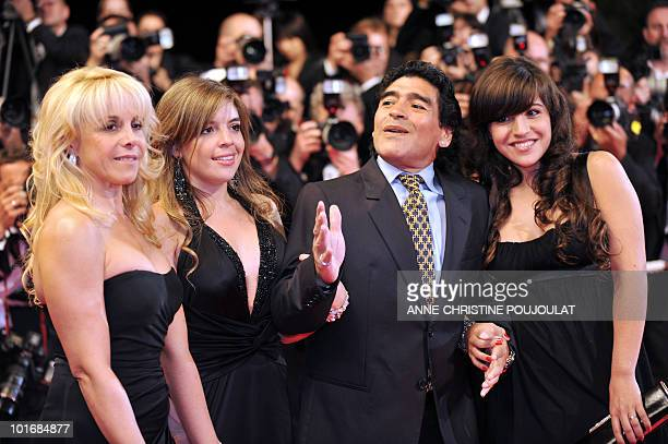 Former Argentinian football player Diego Maradona gestures as he arrives with his wife Claudia and daughters Dalma and Giannina to attend the...