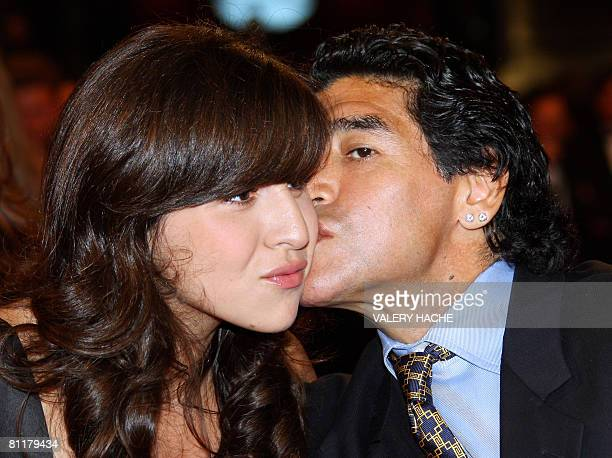 Former Argentinian football player Diego Maradona kisses his daughter Giannina as he arrives to attend the screening of Serbian director Emir...