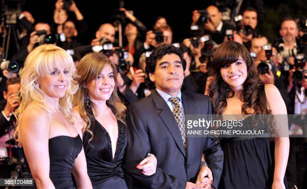 Former Argentinian football player Diego Maradona poses as he arrive with his wife Claudia and daughters Dalma and Giannina to attend the screening...