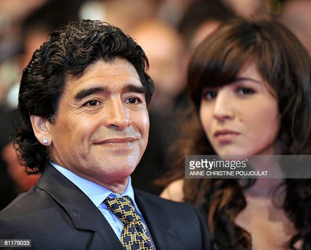 Former Argentinian football player Diego Maradona poses as he arrives with his daughter Giannina to attend the screening of Serbian director Emir...