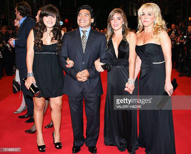 Former Argentinian football player Diego Maradona poses with his wife Claudia and daughters Giannina and Dalma as he arrives to attend the screening...