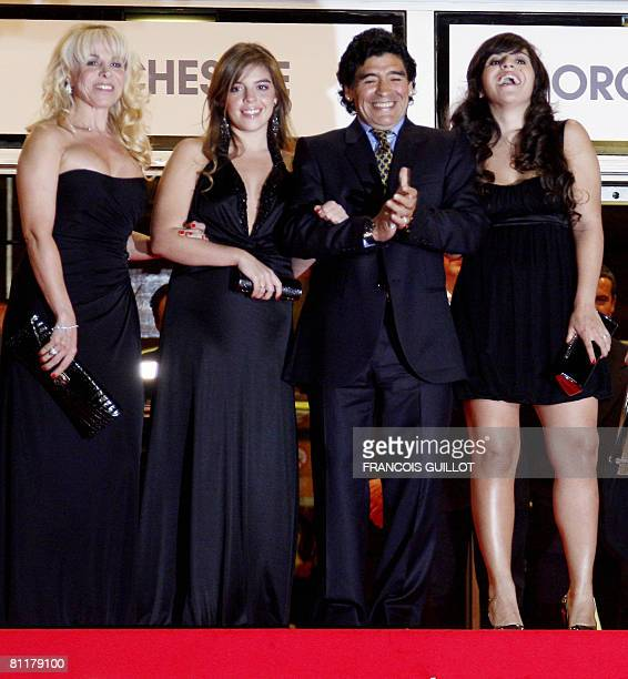 Former Argentinian football player Diego Maradona poses with his wife Claudia and daughters Dalma and Giannina as he arrives to attend the screening...