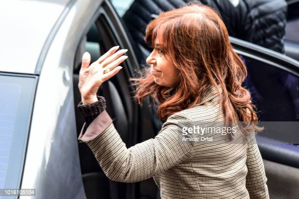 Former Argentinian President Cristina Fernandez de Kirchner waves as she leaves Comodoro Py Courthouse on August 13 2018 in Buenos Aires Argentina...