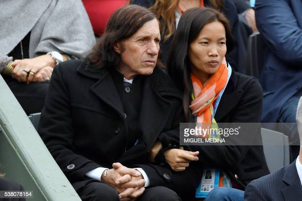 Former Argentinian tennis player Guillermo Vilas attends the women's final match between Spain's Garbine Muguruza and the US's Serena Williams at the...