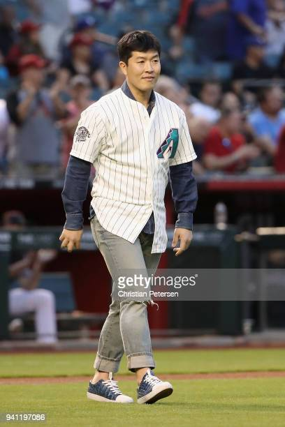 Former Arizona Diamondbacks pitcher Byunghyun Kim walks out for the ceremonial first pitch before the MLB game against the Los Angeles Dodgers at...